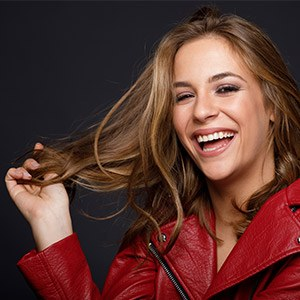woman smiling in red leather jacket