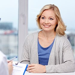woman smiling at front desk