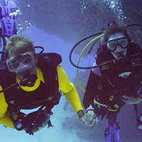 Dr. Boehmer and husband scuba diving
