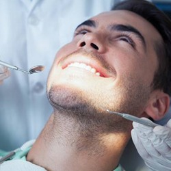 Man getting an oral cancer screening