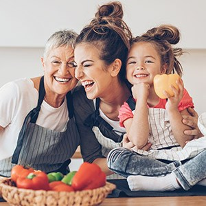 grandmother, mom, & daughter cooking