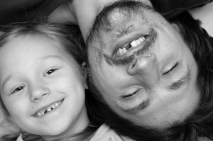 father and daughter with matching missing teeth need to visit the dentist Albuquerque residents trust