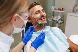 a man in a dentist chair