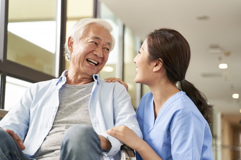 older man in an assisted living facility smiling
